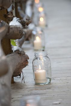 I love the idea of using mason jars + candles to light the path from the venue. Cute & inexpensive. You can also print something on vellum and wrap the jars, or tie twine or burlap.