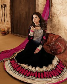 Black anarkali suit with patch embroidery   1. Black embroidered net anarkali suit 2.  Grey yoke with golden embroidery and pink patch embroidery on sleeves 3. Black flare with thread embroidered floral motif and gota border  4. Comes with matching bottom and dupatta