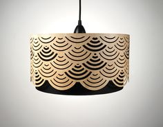 In love with these handmade lampshades made of wood with cut-outs