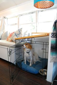 """This dog crate is a pretty special! This pup lives with his humans in a school bus, and his little house was reworked to function as the base of a custom folding table top. According to his humans, """"He still has a place that feels safe and his own, and we have the space we need when he isn't in the crate."""""""