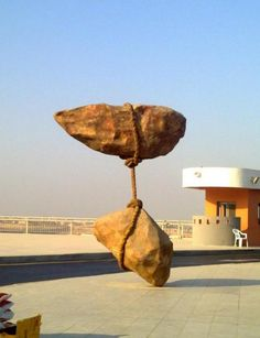 Sculpture at Cairo International Airport seems to defy the Laws of Physics - source Imgur