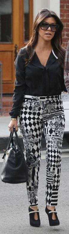 Kourtney Kardashian: Pants – Balmain  Bracelet – Cartier  Purse – Hermes  Shoes – Casadei