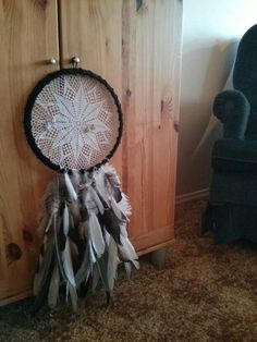 Earring holder; a dream catcher with a crocheted center instead; the ring is actually a broken pot lid that I kept the metal from. Gorgeous.