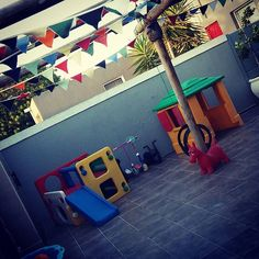 Colour bunting being used a toddlers birthday party