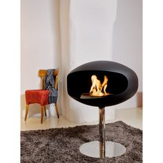 Pedestal standing cocoon fireplace
