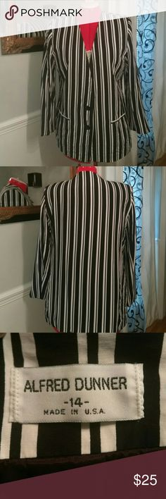 """Beautiful Blazer Beautiful black and white striped Blazer has a two button closure in perfect condition it has no wear or tear. Bust """"40 inches  Top-to-bottom """"29 inches long Alfred Dunner Jackets & Coats Blazers"""