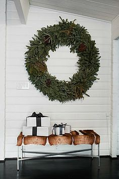 LOVE a simple GIANT wreath..planked walls, white boxes, and that antelope bench..WOW to the WOW