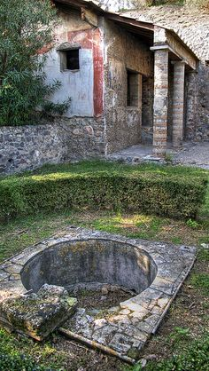 Pompeii Roman House; make a water feature  from reclaimed stone and age-stained concrete and fill, like a ruin that naturally collected water.