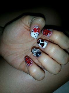 Mickey mouse theme nails.