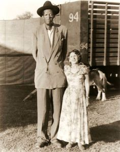 Clyde Beatty Circus publicity photo of their giant Rayford Johnson and famous female sword swallower Mimi Garneau, 1953.