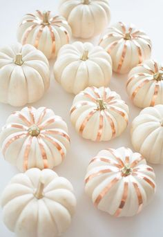 Add metal accent stripes to these cute white pumpkins for your perfect modern fall decor.