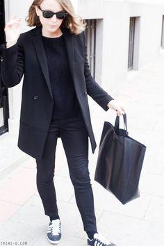 Trini | Acne Studios black jeans The Kooples coat Adidas Gazelle sneakers Céline cabas bag