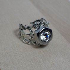 Holy crap....    Hex Nut Ring with Swarovski Crystal  Stainless by diamondsandcoal1, $14.00
