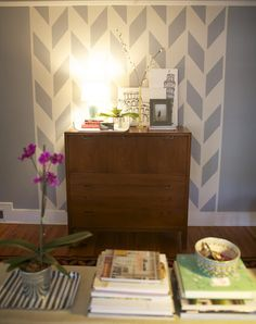 Alternative to hanging frames-paint a pattern directly behind a focal piece of furniture