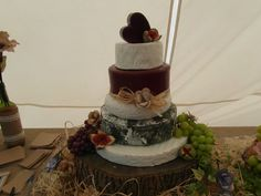 Rustic paper flowers used to decorate a wedding cheese cake!