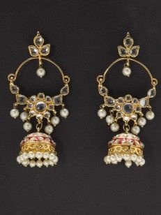Golden earrings with kundan work and pearls