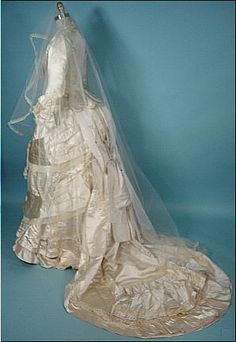 Ivory Silk Satin Bustle Wedding Gown Ensemble - By M. A. Connelly   c.1880  -  Antique & Vintage Dress Gallery    ( View Of Dress With Veil)