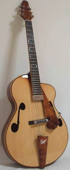 frettedchordophones: Phillippe Clain archtop and he lives in Reunion too! (try finding that on a map) =Lardys Chordophone of the day - a year ago --- https://www.pinterest.com/lardyfatboy/