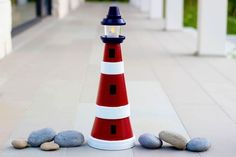 Assorted pots stack up to make this adorable lighthouse.