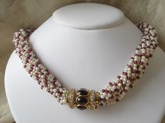 Natural seed pearl and Ruby necklace with a Diamond and Garnet cabochon closure, set in eighteen karat yellow gold/ if Millie's dress stays red will this match?