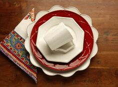 Casafina- red meridian dinner plate, cream meridian charger and white prado salad plate