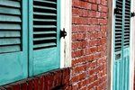 Teal Shutters Red Brick.  I am in love with this color combination. I have red bricks and red shingles on the blue house, so I'm wondering what color I can paint on it and use teal as an accent (like door, shutters, decor, etc.)