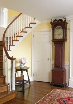 Authentic details of this house in Haverford, Pennsylvania, include the graceful staircase. The tall-case clock was made by Daniel Christ of Kutztown ca. 1790.