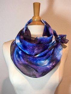 Cosmic deep blues and violets melt together under a flurry of pearl white stars in this beautiful scarf. The silk satin quality gives each color a different glisten with the intermixing matte and satin sheen. Its simply out of this world! Silk Measures 11 x 60 Want to see more scarves from Muse? http://www.etsy.com/shop/MuseSilkPaintings ***A special Thank You to Ellen of Happy Thought who created my beautiful model/fashion illustration! Please stop by her shop at ...