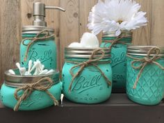 a DIY project for my bathroom for sure! Can also be bought on Etsy! Hand Painted Mason Jar Bathroom Set Mason by MidnightOwlCandleCo Mason Jar Seifenspender, Mason Jar Bathroom, Painted Mason Jars, Bathroom Sets, Bathrooms, Bathroom Bin, Mason Jar Projects, Mason Jar Crafts, Deco Cool