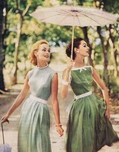 1957 vintage fashion style grey green dress day wear white belt bow pleated skirt sleeveless late 50s era