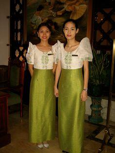 Beautiful ladies at the Manila Hotel - wearing the classic Maria Clara dresses.