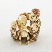 Mammoth Ivory Netsuke -  Father Lifting A Mask With 2 Kids