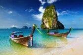Tropical beach, longtail boats, Andaman Sea, Thailand stock photography
