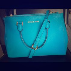 Michael Kors Sutton Bag Gorgeous summer blue color in perfect condition! I wore it once and got tons of compliments. So many skippered pockets, and a strap included so you can wear it shoulder/cross body. Michael Kors Bags Shoulder Bags