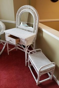 """White painted wicker furniture incl glass top table, Pair of chairs, rocker, vanity with stool and seat cushions. Table 30""""diam x 29.5'H; chairs each 30""""Wx29""""Dx34.5'H; rocker 30'Wx34""""Dx34.5""""H; vanity with single drawer and attached round top mirror, 30""""Wx18'Dx53.5""""H to mirror with stool; three seat cushions and pillow."""