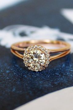 27 Rose Gold Engagement Rings That Melt Your Heart ❤️  rose gold engagement rings diamond halo round cut split shank ❤️ See more: http://www.weddingforward.com/rose-gold-engagement-rings/ #wedding #bride #engagementrings #rosegoldengagementrings