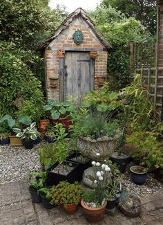 I like the weathered door and old brickwork on this garden shed - you could probably do the same by buying reclaimed bricks and doors.