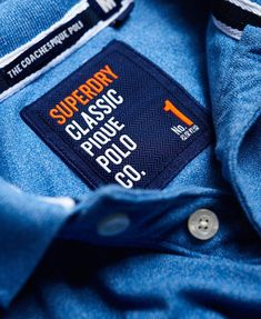 An essential piece for any wardrobe, our range of men's polo shirts includes long and short-sleeved options. Shirt Label, Clothing Labels, Fashion Labels, Polo Shirt, T Shirt, Label Design, New Man, Superdry, Branding Ideas