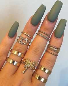 This matt color is awesome. Love the rings too! #fashion #nailart #beauty