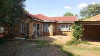 Set on 4 064 square meters, the Main House offers, 3 Bedrooms, 2 bathrooms, Country Kitchen, Dining Room and Lounge. Alarm system. Swimming Pool. Patio, 3 Car Ports. Flat consists of open plan Lounge and Kitchen, 2 Bedrooms and Bathroom. Maids quarters, fully walled with a bird aviary.
