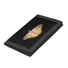 Painted Lady Butterfly ~ wallet ~  A colorful and furry Painted Lady butterfly cut-out on black.