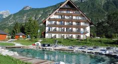 Hotel Mangart Bovec The newly built Hotel Mangart can be found in Bovec on the edge of the Triglav National Park. The rooms and suites feature a balcony, a cable TV, a mini bar and free Wi-Fi.  A wellness area with a hot tub and a sauna invites you to relax.