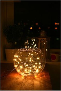 Fish bowl fairy lights - great little centre piece idea.  Wrap the battery pack in tin foil to cover.  Could also add decretive marbles or use a lay's flowers and glue onto the lights.