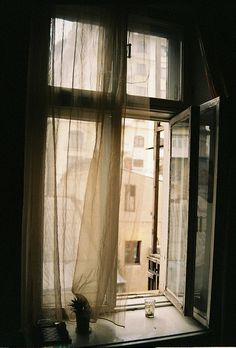 The open window to me signifies freedom, opportunities, possibilities. I also like that you can imagine this is a flat in Europe. Overall though, the picture is a little too dark for my taste.