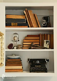 Styling built-ins!   Love turning the books around…great vintage look.