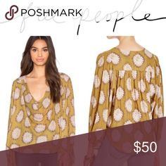 """Free People Gold Cowling Around Top Semi sheer cowl neck blouse featuring wide sleeves with elastic cuffs. Gathered back detailing and rounded hem. Flowing silhouette for an effortless, easy fit.  100% Polyester Machine Wash Cold Import Bust: 48.0"""" = 121.92 cm Length: 23.25"""" = 59.06 cm Sleeve Length: 22.5"""" = 57.15 cm Free People Tops"""