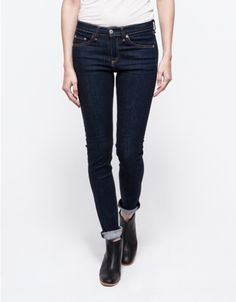 High rise skinny denim from Rag & Bone. Features classic 5 pocket styling, zip fly, and contrast stitching, and sits at the middle of the waist with a skinny fit.  Wash: Heritage (dark blue) 98% Cotton, 2% Polyurethane  Made in USA