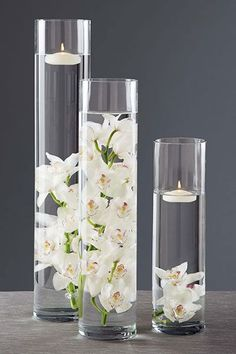 White candle reception wedding flowers,  cylinder vase centerpiece