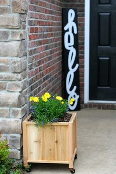A DIY planter box on wheels is perfect for decorating a front porch or patio. This cedar planter works for flowers, herbs, veggies, or even berries! Cedar Planters, Diy Planter Box, Diy Planters, Outdoor Landscaping, Outdoor Decor, Garden Inspiration, Garden Ideas, Diy Storage, Porch Decorating