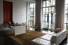 The 14-foot-long dining table descends from the wall like a Murphy bed.    Read more: http://www.dwell.com/slideshows/city-modern-home-tours-manhattan.html?slide=36=y=true#ixzz291ULLIGu